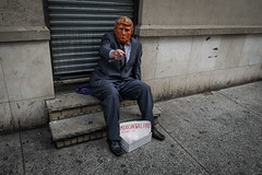 DSCF3501 (john fullard) Tags: street nyc orange newyork color colour wall march costume mask explore trump 2016 fujixpro1