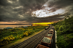 Freight To The Sunset (jeanmarie shelton) Tags: ocean light sunset sky sunlight beach nature water colors night clouds train reflections landscape outdoors nikon tracks shore waterscape jeanmarie jeanmarieshelton
