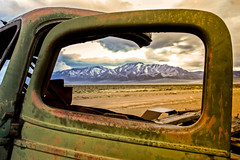 Wndow View (http://fineartamerica.com/profiles/robert-bales.ht) Tags: people snow mountains ford window beautiful vintage landscape photo junk desert antique awesome nevada rustic scenic rusty surreal peaceful places super retro nostalgia chrome transportation western vehicle sensational headlight states projects grille chassis windshield oldcar sublime magnificent rollinghills collector modelt classictruck desertlandscape ponyexpress haybales phonecase forupload scenicphotography oldcarandetc robertbales oldpickupoldtruck oldwestphotography oldcollectable schellbouonestation
