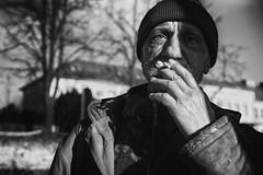 _DSC7527 (Zdenek Jasansk) Tags: street shadow portrait eye face look eyes cigarette gipsy bianonegro