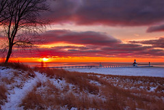 1-23 Sunset in St Joseph (PhotoJacko - Jackie Novak) Tags: longexposure sunset sky lighthouse snow beach nature silhouette clouds solitude wintersunset michigan lakemichigan sanddune winterlandscape ndfilter stjosephmichigan 10stop tiscorniapark