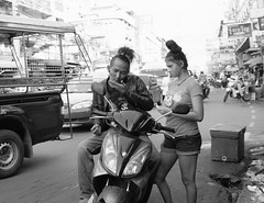 Made For Each Other (Martyn61) Tags: street travel boy blackandwhite bw girl monochrome tattoo hair neck thailand outside mirror crazy looking streetphotography style social motorbike your motorcycle suzuki comb vain inlove chonburi socialdocumentaryphotography fuifilm x100t oddcouplemarket