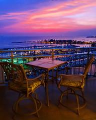 Evening moods (peggyhr) Tags: pink blue sunset green marina reflections table boats hawaii purple chairs violet thegalaxy 50faves peggyhr heartawards dragondaggerawards alawaiharbour level1photographyforrecreation thegalaxyhalloffame thelooklevel1red thelooklevel2yellow thelooklevel3orange thelooklevel4purple frameit~level01~ frameit~level02~ musictomyeyes~l1 sun|sky|cloud level1peaceawards dsc02526ax