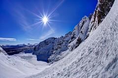Falling away from me (pauldunn52) Tags: mountain snow west scotland frozen north an sunburst lochan teallach