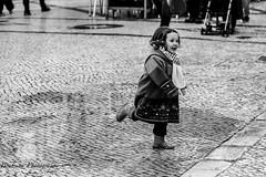 La fillette de Lisbonne (Bouhsina Photography) Tags: street blackandwhite bw white playing black portugal water smile canon puddle agua eau noir child noiretblanc pavement lisboa pluie running rua rue enfant sourire blanc bonheur bottes lisbonne flaque jouer heureuse pave bouhsina 5diii ef247028ii bouhsinaphotography