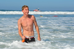 Smiling Young Swimmer (Chris Hunkeler) Tags: shirtless man water young foam edge boardshorts