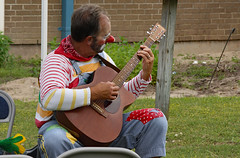 Now For Something Completely Different (ertolima) Tags: musician music bluegrass guitar clown performance instruments picking
