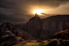 The Eye (doraartem) Tags: sunset sun nature landscape rocks dramatic greece sunrays meteora