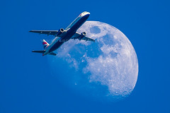 Passing the Moon (iesphotography) Tags: london plane canon airport aircraft aviation aeroplane landing airbus boeing airways takeoff runway spotting jumbo planespotting luftfahrt airplanepictures photocompetition aircraftengine koku kaisha feiji planespotter airplanephoto lotnictwo aircraftspotting gongsi luchtvaart aviationphotography 1dx aviationimages aircraftregistration aircraftphoto aircraftpictures aircraftphotography havacilik aircraftarrival aviacin aviao aviationphotogallery aircraftdeparture aviationphotocompany hngkong