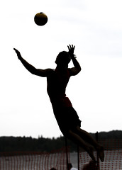 In the Sky (Beach Volleyball.) Tags: sky man men beach sports silhouette sport canon athletic beachvolleyball 7d volleyball athlete serving