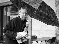 . (alb.montagna) Tags: street portrait people blackandwhite monochrome umbrella streetphotography streetportrait zuiko olympusomdem10mkii