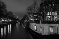 Living on the edge (McQuaide Photography) Tags: old city longexposure nightphotography winter light urban blackandwhite bw holland reflection water netherlands monochrome dutch amsterdam architecture night zeiss photoshop vintage outside mono licht blackwhite lowlight europe nacht outdoor sony traditional tripod capital nederland houseboat fullframe alpha residence residential oud stad authentic manfrotto noordholland gracht lightroom canalhouse capitalcity 1635mm woonboot northholland a7ii grachtenpand korteprinsengracht variotessar mirrorless sonyzeiss mcquaidephotography ilce7m2