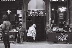 Caffe Reggio, since 1927 (DoubleBen) Tags: city nyc original newyork film coffee shop 35mm vintage cafe nikon village manhattan greenwich delta iso 100 f2 ilford cappucino 1927 regio caffereggio