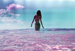 Amethyst Shore (Hayden_Williams) Tags: ocean summer film beach girl analog swim vintage lomo lomography waves puertorico tide grain shoreline hipster retro bikini indie analogue nikonosv standinginwater lomochromepurplexr100400