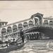 Gondola passing beneath the Rialto Bridge in Venice, Italy
