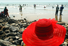 A red hat on the beach (Rajib Singha) Tags: street travel red people india color beach interestingness westbengal digha nikond200 eastmidnapore flickriver mfnikkor20mmf35ailens