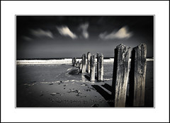 beach groynes at sandsend, near whitby. (raymondstewart1) Tags: sky blackandwhite texture beach clouds skyscape mono groyne cloudscape sansend northyorkshirecoast beachgroynes