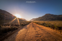 Road to Cederberg (Chiara Salvadori) Tags: africa travel winter light sunset wild sun nature colors landscape southafrica spring scenery rocks desert sundown outdoor dirt dirtroad traveling wilderness westerncape sudafrica cederberg cederbergwildernessarea