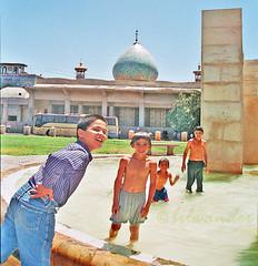 Iran, Shiraz, kids  having fun in a fountain pool (bilwander) Tags: kids iran bilwander shirazfountain