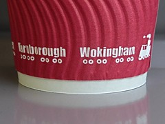 Wokingham on bogies (Wider World) Tags: red england white reflection cup train paper graphic wheels engine steam printing railways farnborough corrugated disposable bogie wokingham papercup eastleigh cafedestino