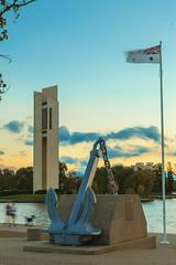 The Carillon (DrSchabbs) Tags: blue sunset orange yellow movement memorial colours dusk flag australia anchor canberra colourful flagpole radiant act hmas australiancapitalterritory hmascanberra nationalcarillon
