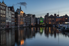 Arrival in Amsterdam (McQuaide Photography) Tags: old city travel windows light urban house holland reflection tourism window water netherlands dutch amsterdam skyline architecture zeiss photoshop vintage outside licht canal twilight lowlight europe outdoor dusk sony traditional tripod capital nederland ramen adobe bluehour fullframe alpha huis centrum oud touristattraction stad authentic raam manfrotto noordholland gracht schemering lightroom huizen damrak canalhouse capitalcity 1635mm northholland a7ii grachtenpand famousplace variotessar mirrorless sonyzeiss mcquaidephotography ilce7m2