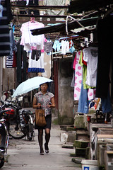 Backstreet  Shanghai (Julien Mailler) Tags: world china street travel woman lady umbrella asian julien alley asia shanghai chinese backstreet laundry asie chinois chine nationalgeographic asiatique reflectionsoflife lovelyphotos jules1405 unseenasia earthasia mailler