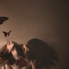 What Saves The Struggle (tearesnick) Tags: light red art texture girl wall canon butterfly dark hair 50mm fineart butterflies surreal negativespace heads conceptual hairflip canonrebelt5i