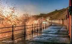 Beach huts at dawnrz (Bev Cappleman) Tags: sea sunrise waves seawall whitby splash breakingwave watersplash