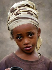 Dorze girl (Linda DV) Tags: africa street travel portrait people cute girl face canon children geotagged kid child candid young kind ethiopia discovery enfant chencha 2010 younggirl worldtravel travelphotography travelportrait dorze powershots5is exploretheworld lindadevolder picmonkey