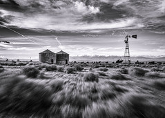 Somewhere near Lake Elizabeth (Eric Zumstein) Tags: sky motion mountains broken windmill clouds canon desert wideangle 40d