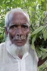 H504_3295 (bandashing) Tags: old portrait england white man tree green face festival beard manchester shrine foliage sylhet bangladesh socialdocumentary mazar aoa shahjalal bandashing akhtarowaisahmed treecuttingfestival