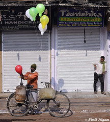 Streets Of Delhi (nimitnigam) Tags: street camera new old red india white streets color green colors bicycle lens photography 50mm prime photo frames nikon colorful photographer market photos delhi indian ballon balloon streetphotography photographers photographs photograph cycle catcher nikkor seller bazar newdelhi nimit d800 nigam olddelhi chowk travelindia indiatravel primelens chandini streetsofindia peopleofindia indiacity delhi06 bazat chandnichwok delhite delhi6 nikond800 f18g lonelyplanetindia nimitnigam framescatcher lpindia talkingstreetseries talkingstreetsseries
