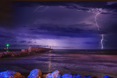 Orage (Amanclos) Tags: longexposure light wallpaper lighthouse seascape storm water night lights waves lightning orage waterscape seacape lightnings clair clairs