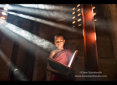 A young monk reading with rays of sunlight in the temples of Bagan, Myanmar (jitenshaman) Tags: travel light asian religious temple reading book asia robe burma buddhist religion monk buddhism unesco read holy monks temples destination myanmar burmese sanskrit pagan bagan robes novice nyaungu worldlocations