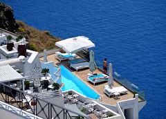 Wish you were here in Santorini, Greece (` Toshio ') Tags: city people woman man water pool umbrella island view swimmingpool santorini greece bikini sunbathing mediterraneansea fira toshio xe2 fujixe2