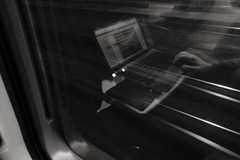 Traveling fast, working hard (Ciccio Pizzettaro) Tags: railroad travel reflection train notebook traveling vaio