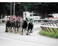 A Sunday In NewYork (Shot by Newman) Tags: horses rain sport 35mm daylight track rail upstateny vehicles jockeys fujifilm riders fuji400 nyra saratogany saratogaracecourse muddytrack shotbynewman