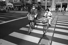 Ueno, Tokyo (fabiolug) Tags: street leica light shadow people blackandwhite bw monochrome lines sunglasses bike bicycle japan self japanese tokyo glasses cyclists blackwhite asia cyclist crossing shadows mask ueno 28mm wheels wide streetphotography bikes rangefinder wideangle masks monochrom biancoenero elmarit leicam elmarit28mm leicaelmarit28mmf28asph elmarit28mmf28asph leicaelmarit leicaelmarit28mm mmonochrom leicammonochrom leicamonochrom