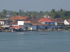 Cochin (BenZ-fotos) Tags: houses india port buildings river boats fishing marine asia waterfront fishermen masonry kerala roofs maritime canoes cochin kochi ernakulam dwellings arabiansea rooftiles dugouts 5photosaday pitchedroof fareastexplorer