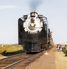 Union Pacific FEF-3 class 4-8-4 Northern steam locomotive # 8444, is seen at the end of a rail fan excursion train photo run-by on a main line in Colorado, 1980 - 4 (alcomike43) Tags: old people color classic up modern vintage ties photo smoke tracks engine photographers trains historic steam passengers negative photograph rails fireman unionpacific locomotive northern spikes steamengine observers railroads onlookers ballast rightofway steamlocomotive 484 alco mainline oilburner passengertrains roadbed railfans 8444 fef3 tieplates anglebars conventionaljointedsectionrail railfanexcursiontrains cabcrewmember