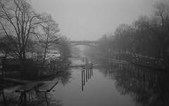 Fog over Stockholm (Indofunk Satish) Tags: bridge trees winter mist water monochrome fog river blackwhite sweden stockholm trix hc110 olympusxa