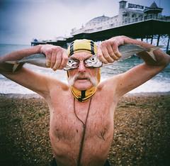 Dave Sawyers & His Fish (lomokev) Tags: portrait fish man male beach mediumformat person pier lomo lomography brighton human brightonpier palacepier superdave davesawyers lomolca120 file:name=150730lomolca120lomocn800000009hi3677