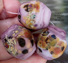Rocks Lavender Lilac Silvered (Laura Blanck Openstudio) Tags: show pink etched usa brown abstract green art glass rose festival set silver beads leaf big italian rocks colorful published artist glow purple handmade stones teal fine arts violet fuchsia lavender funky jewelry pebbles sage made odd caramel lilac honey earthy burnt winner mauve opaque organic wearable nuggets murano umber lampwork multicolor raku artisan matte whimsical loose frosted frit petroleum openstudio asymmetric ocher speckles tumbled silvered openstudiobeads