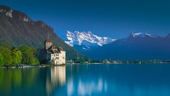 Evening mood at the Chateau de Chillon - Chillon (Sinar84 - www.captures.ch) Tags: old blue trees red sky orange white lake black mountains reflection green water yellow switzerland evening spring swiss hill gray clear chillon castel 2016 veytaux lacleman chateaudechillon
