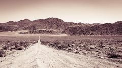 The valley of death (John Getchel Photography) Tags: california blackandwhite us nationalpark unitedstates deathvalley salinevalley splittone