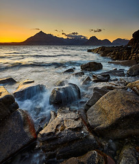 Elgol Sunset, Isle of Skye, Scotland (ajnabeee) Tags: sunset orange lake mountains skye water yellow scotland rocks waves dusk tide hills incoming loch cuillins isle munro elgol