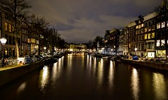 Amsterdam at Night (Weekend Wayfarers) Tags: street city travel streets travelling netherlands amsterdam boats boat canal travels europe cityscape travellers cityscapes travellings adventure nightscene traveling streetscape travelers travelblog nightpicture nightscenes travelphotography nightpictures travelphotographer travelblogs travelblogger travelings travelbloggers travelphotographers travelblogging weekendwayfarers