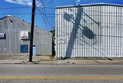 Houston, TX (otro_mun2) Tags: street light urban signs color building landscape industrial texas shadows decay steel telephone houston service poles mundane deutz contemporarylandscape