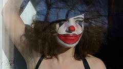 Sad clown (debahi) Tags: windows red portrait woman black window neck rouge nose mujer eyes nikon sad arm retrato interieur clown femme curvy triste curly brunette nikkor nez payaso personne brune fenetre bras maquillaje cheveux exterieur boucl ondul d7100 cmwd cmwdred